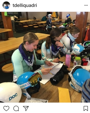 Student-athletes keep up with their school work where they can, often reading on the bus or doing homework in the lodge. (Photo: Mr. Terry DelliQuadri)
