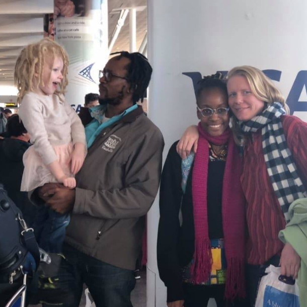 Ms. Carmichael (right) on Thanksgiving Day with her family (from left to right, Taika, Chisondi and Monica) at JFK Airport shortly after Chis and Monica arived from Tanzania (Photo provided).